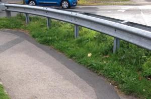 Weeds need strimming at end of Ridgeway