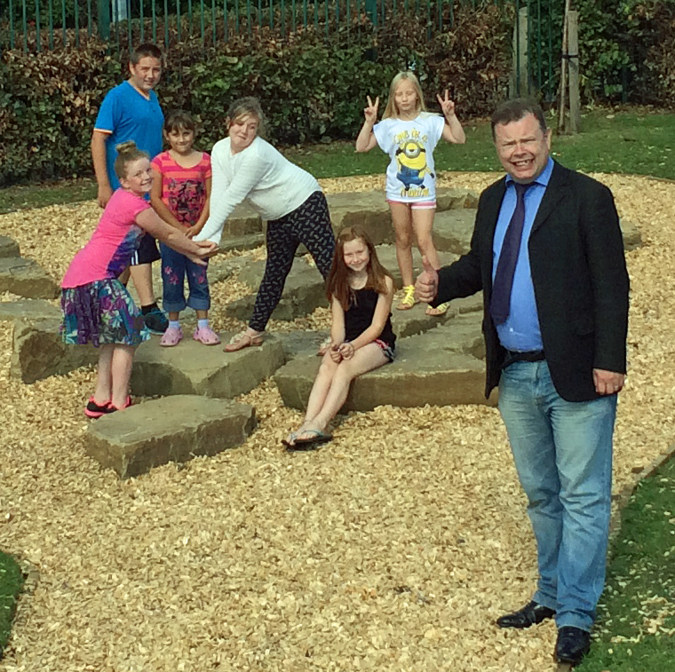 Andrew Waller with users at the newly reopened Woodlands playground