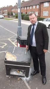 Cllr Andrew Waller with one of the salt bins that he has asked to be refurbished and refilled