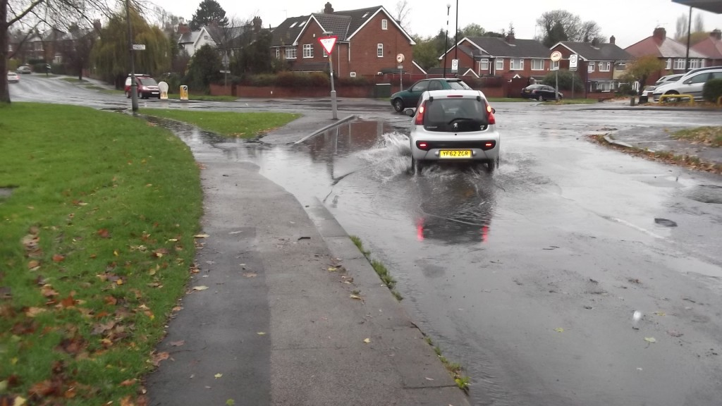 Footpath and carriageway flooded on Acomb Green