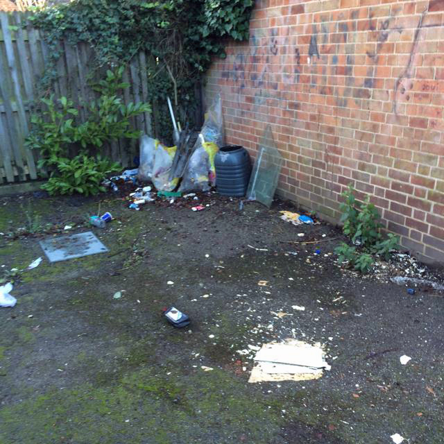 Fly tipping on Council garage areas