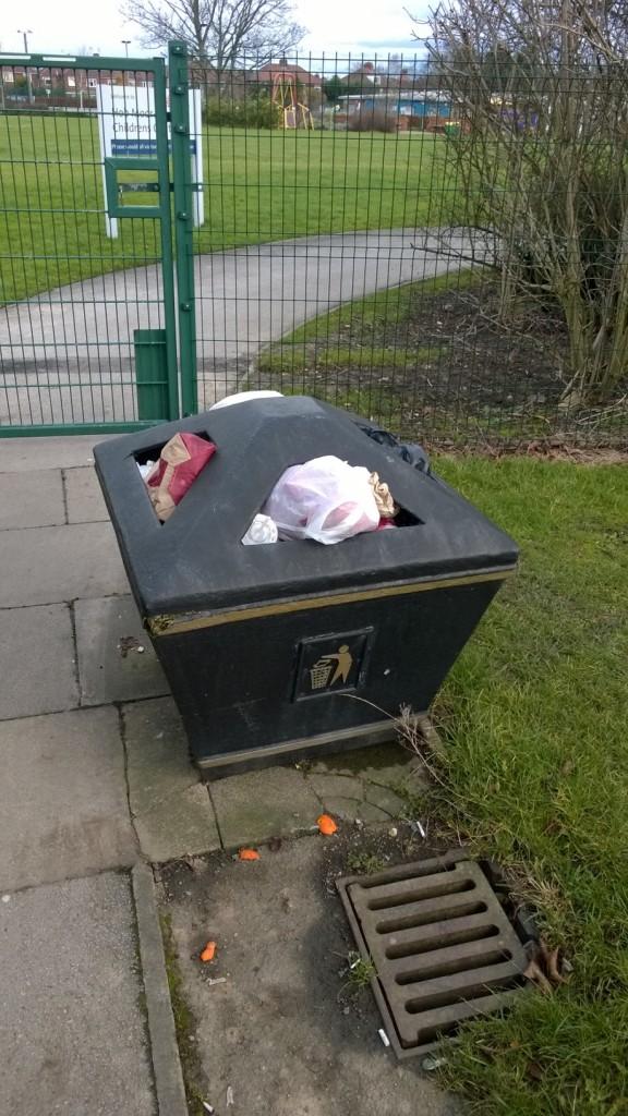 Full litter bin on local footpath