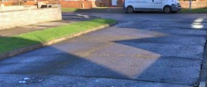 Road surfaces in Queenswood Grove breaking up