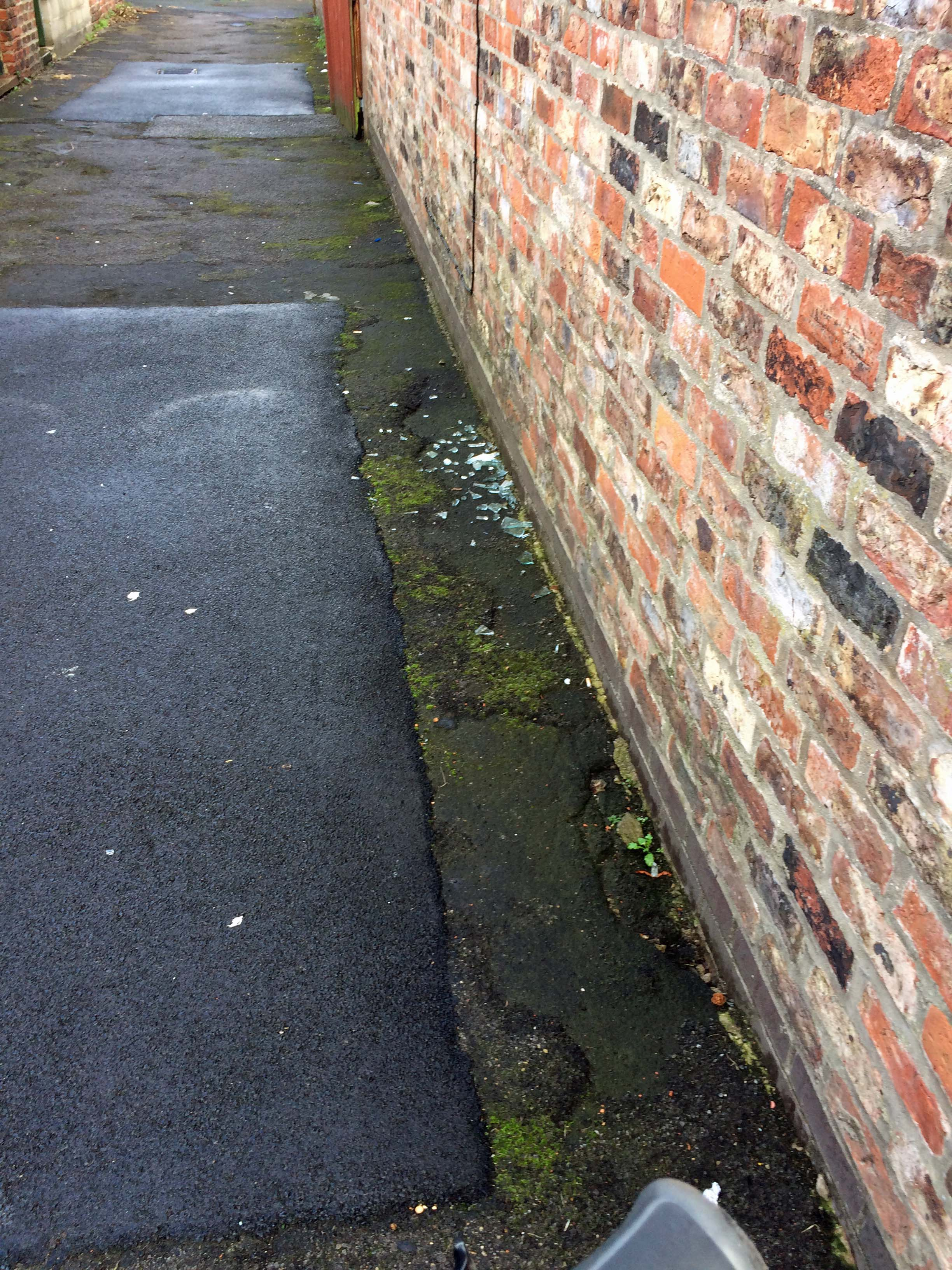 Broken glass on School Street back lane - outstanding for two weeks