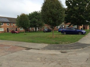 Cars parked on grassed amenity area in Windsor Garth