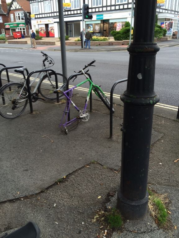 Abandoned bike on rack off York Road