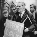 """Tony Benn Labour Member of Parliament A poster being thrust in front of Mr Wedgwood Benn when he and Mr Jeremy Corbyn, the bearded Labour MP for Islington North, visited Belfast to condemn """"supergrass"""" trials in Ulster."""
