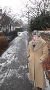 Cllr Sue Hunter on a steep footpath on Front Street where acces to a salt bin is essential for safety