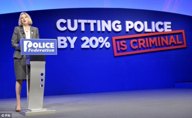 Teresa May police cuts