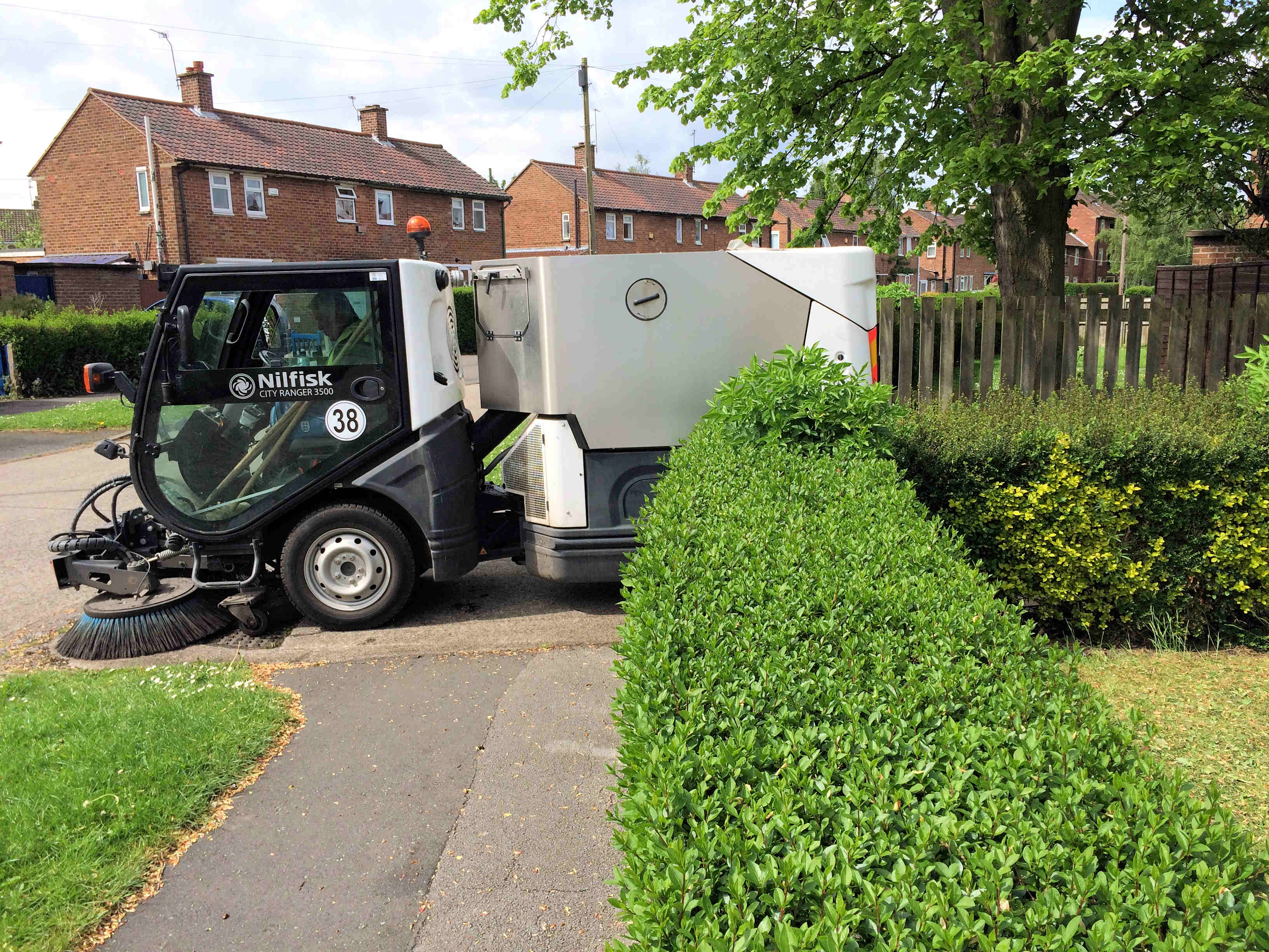 Street sweeper cleaning garage area in Thoresby Road