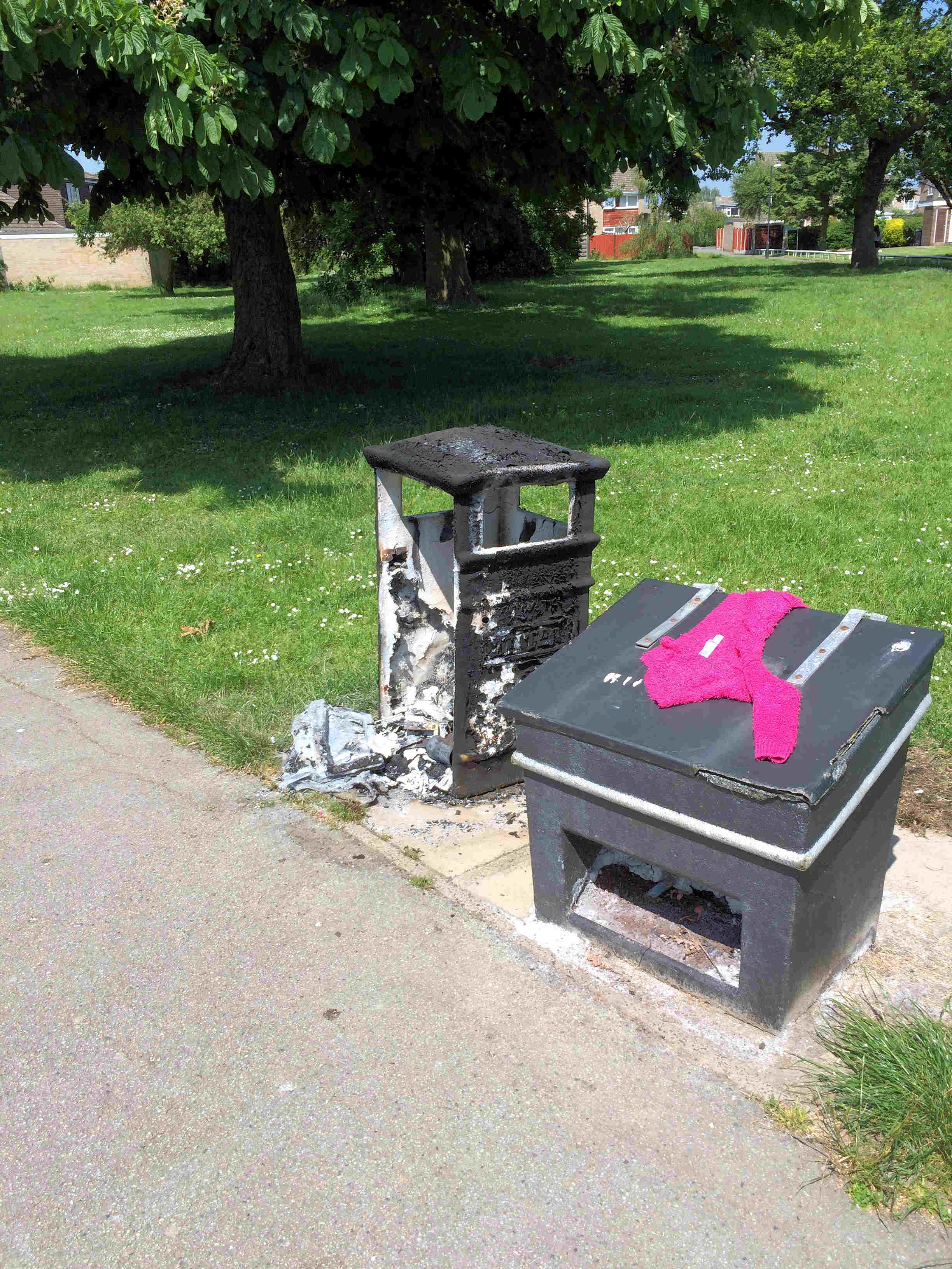 Burnt out bin on Woodthorpe Green