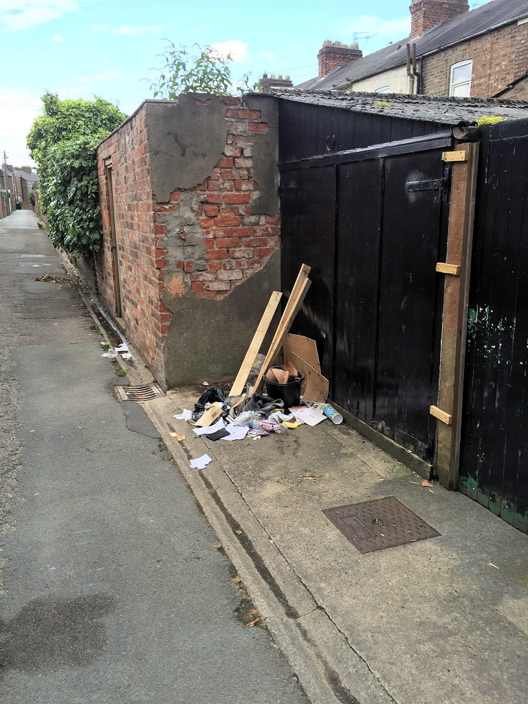 Fly tipping in Gladstone Street back lane