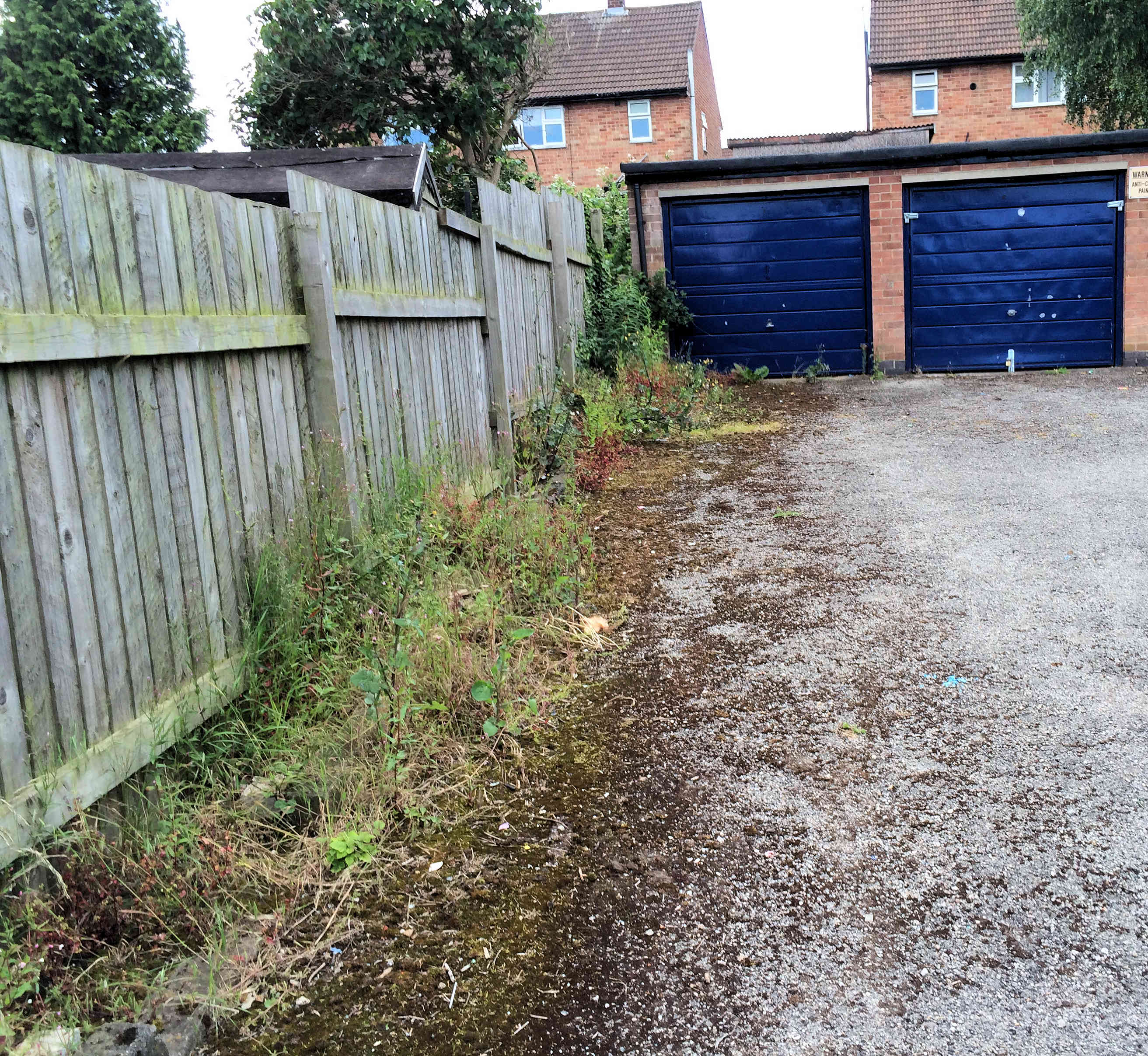Marston Avenue garage area has still not been cleaned up and resurfaced. We've registered a formal complaint