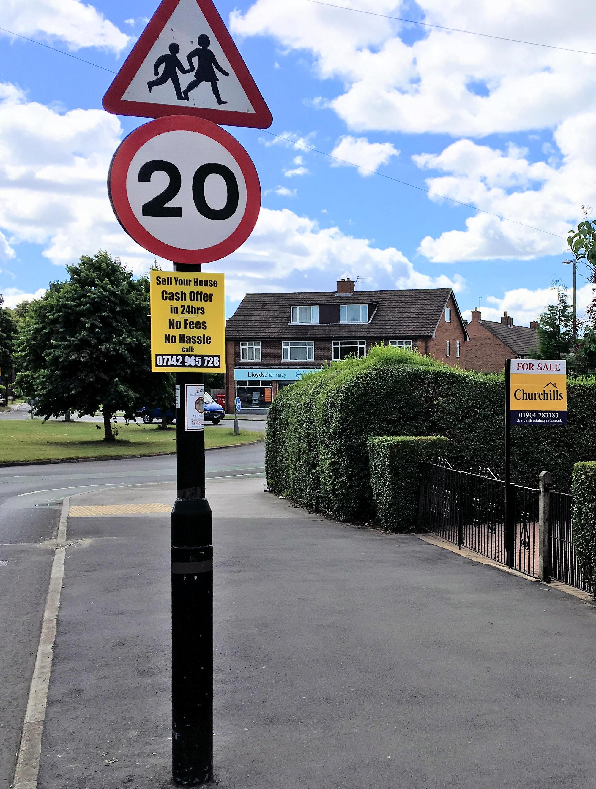 Unauthorised lamppost adevrtising