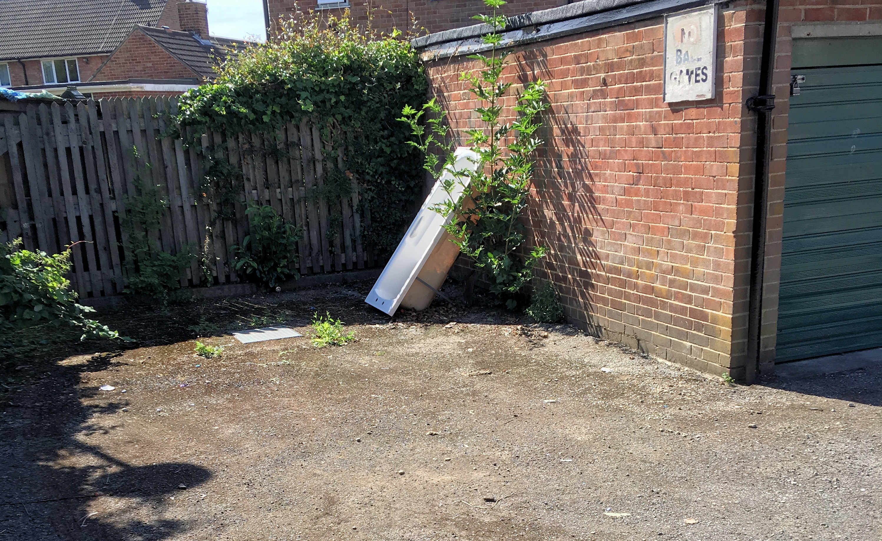 Dumped bath Green Lane garage area