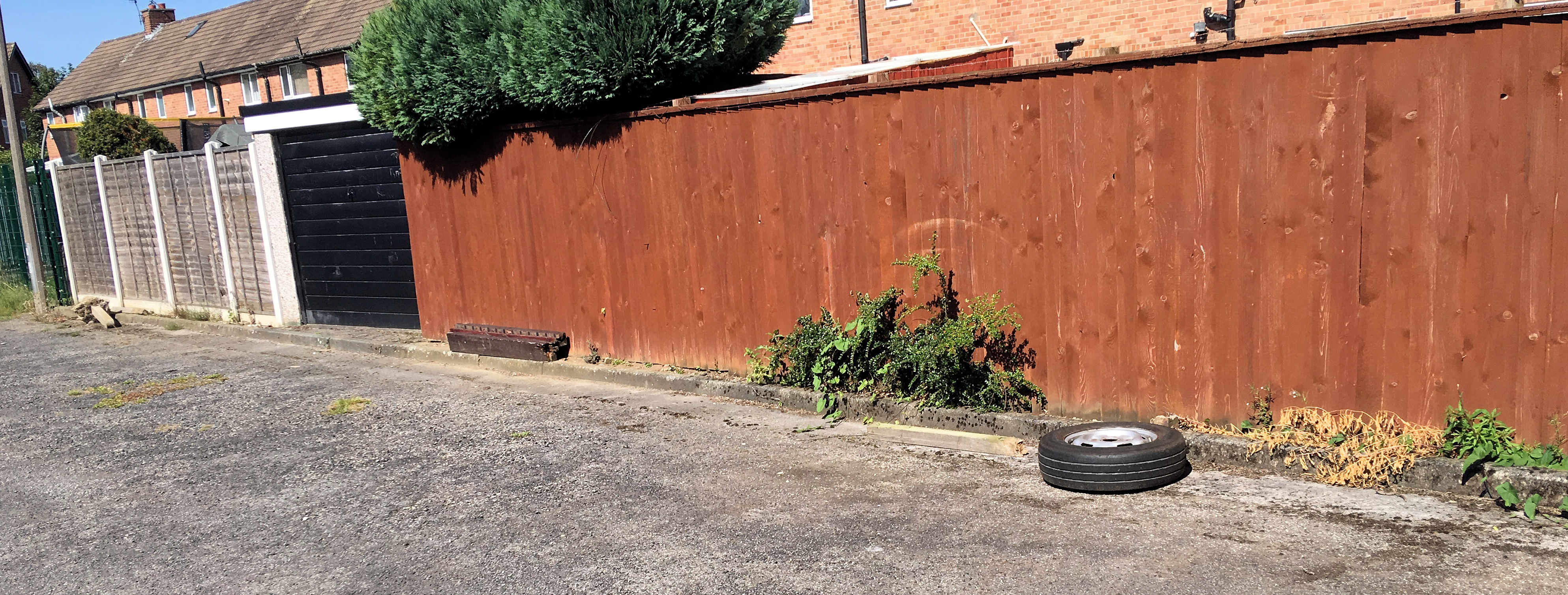 Green Lane garage area dumped spare wheel