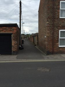 Sacks out early in back lane