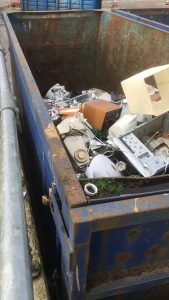 Electrical equipment skip at Hazel Court.