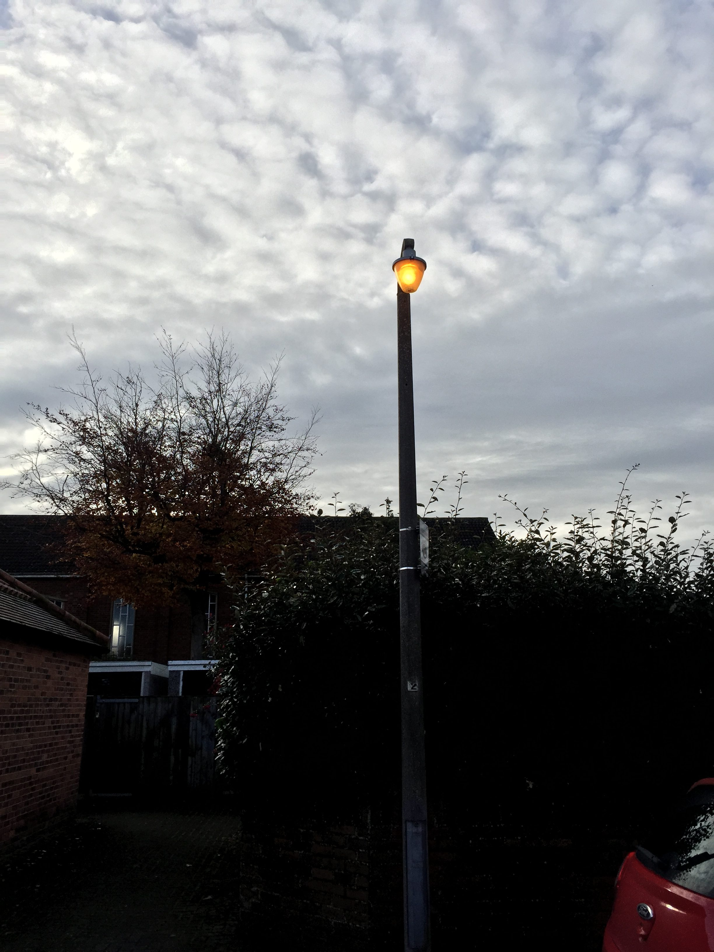 and day burnign street lights